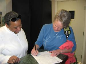 Mixed race gay couple applying for marriage license. Loving Day celebration.